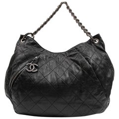 CHANEL Messenger Bag in Aged Soft Gray Quilted Lambskin Leather