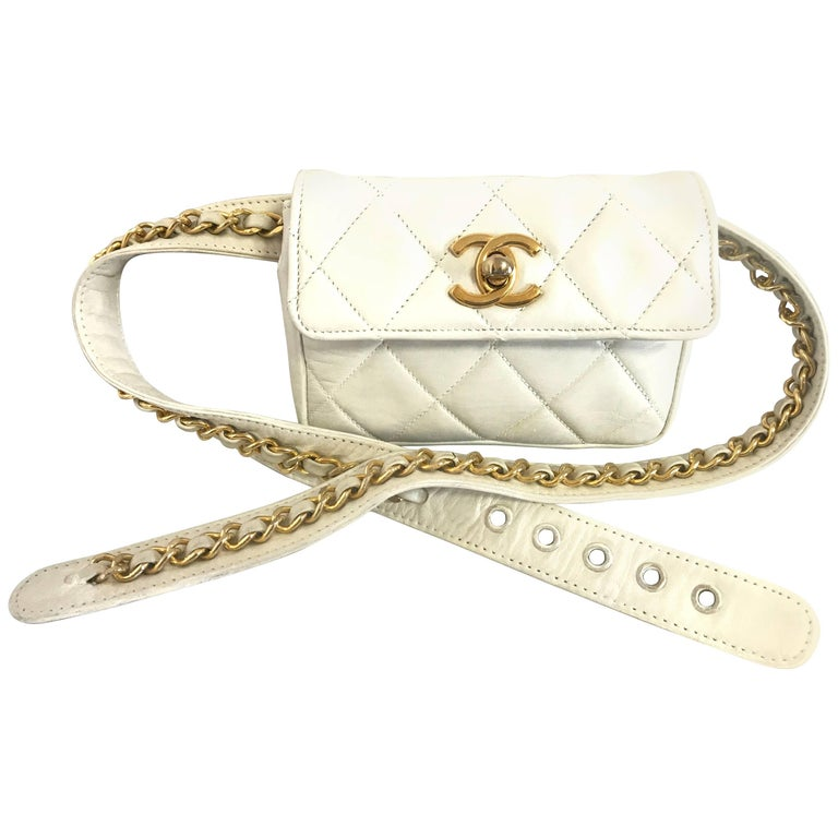 Vintage CHANEL white small waist purse, fanny pack, hip bag with gold CC motif.