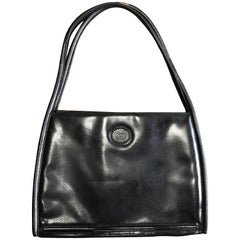 Vintage Gucci black pigskin large trapezoid shape shoulder bag with embossed GG.
