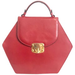 Vintage Bottega Veneta grained red leather hexagon shape handbag with gold motif