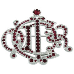Christian Dior Silver Toned Faux Ruby Insignia Brooch