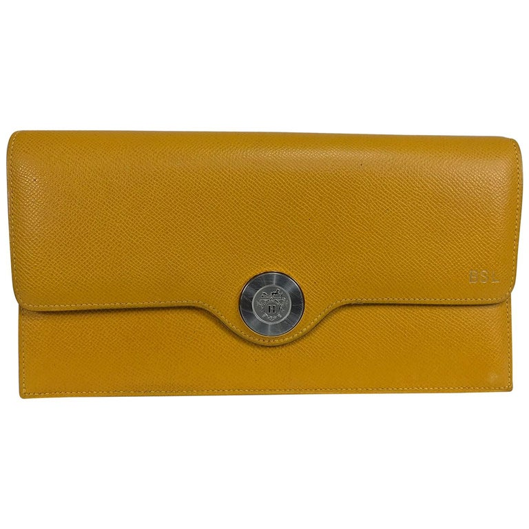 Hermes Mustard yellow pebbled leather clutch