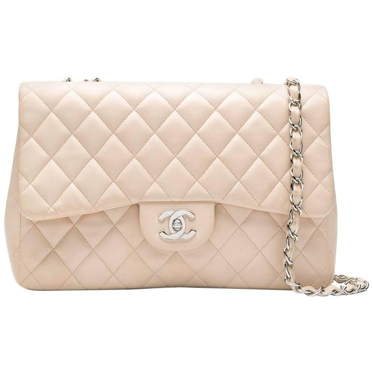 17e4bb363643 Chanel Classic Flap Bag For Sale. Crafted from luxurious lambskin leather  ...