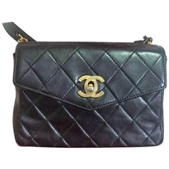 Vintage CHANEL black waist purse, fanny pack with golden CC and chain belt. Rare