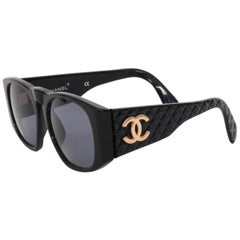 A Pair of 1980s Chanel Sunglasses with Quilted Sides and Gold Toned Chanel Logo