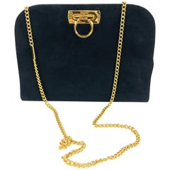 Salvatore Ferragamo black suede gold hardware clutch shoulder bag