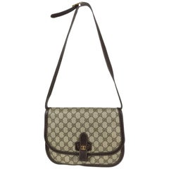 Gucci logo canvas and leather trim flap shoulder bag