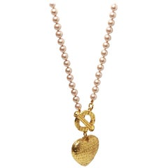 Givenchy pearl necklace with gold ring and heart pendant