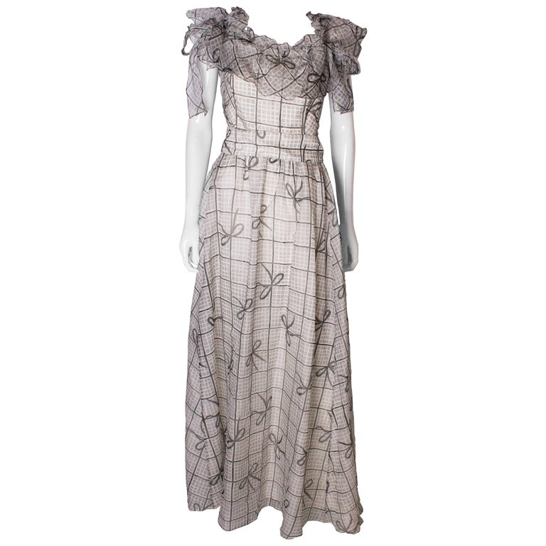 A Vintage 1970s grey printed silk evening gown by Gina Fratini For Sale