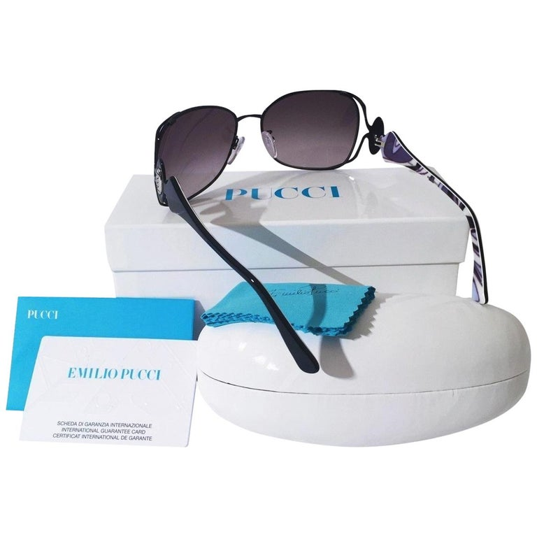 Emilio Pucci Sunglasses Brand New * Stunning Classic Pucci Sunglasses * Black Aviator Frames * Pucci Print Sides: * White, Purple & Blue * Silver Pucci Logo on Both Sides * Handmade ZYL in Italy * 100% UV Protection * Comes with Case, Cleaning