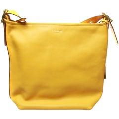 Coach large ladies yellow handbag duffle crossbody with dust cover and gold hard