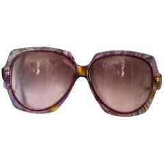 A pair of Vintage 1970s sunglassses by Oliver Goldsmith