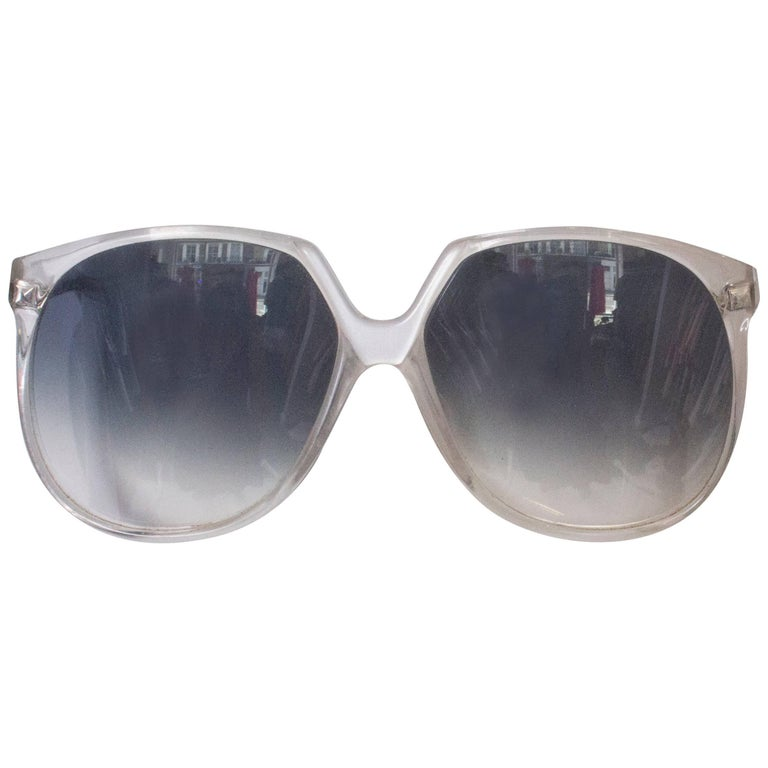 A pair of Vintage 1970s Sunglasses with White Frames