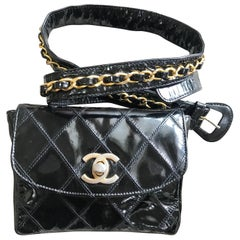 Vintage CHANEL black patent enamel belt bag, fanny pack with CC closure.