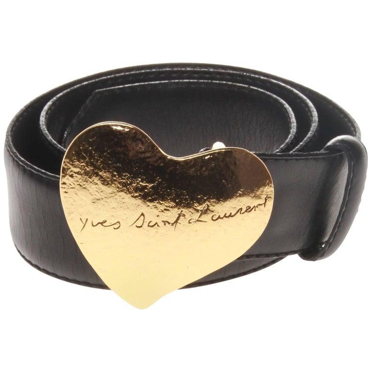 Yves saint laurent black leather belt with heart buckle