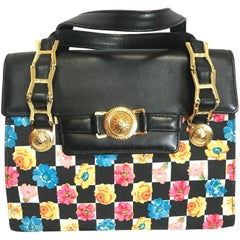 Vintage Gianni Versace black leather and pink, orange, and blue flower prints
