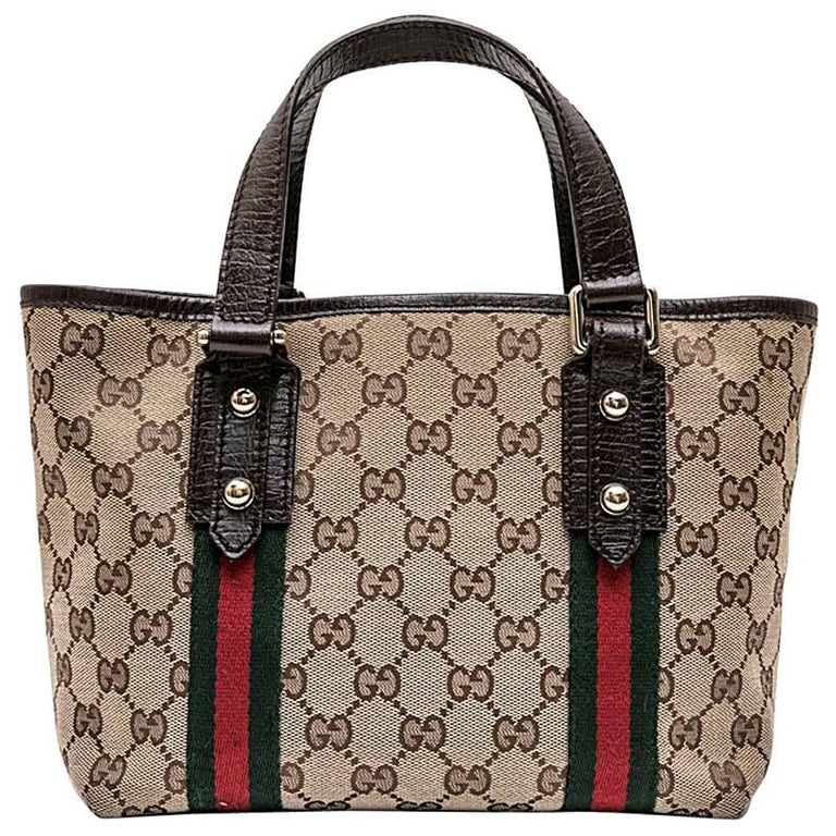 6ce01e069b5 GUCCI Vintage Bag in Brown and Beige Monogram Canvas with Red and Green  Stripes For Sale