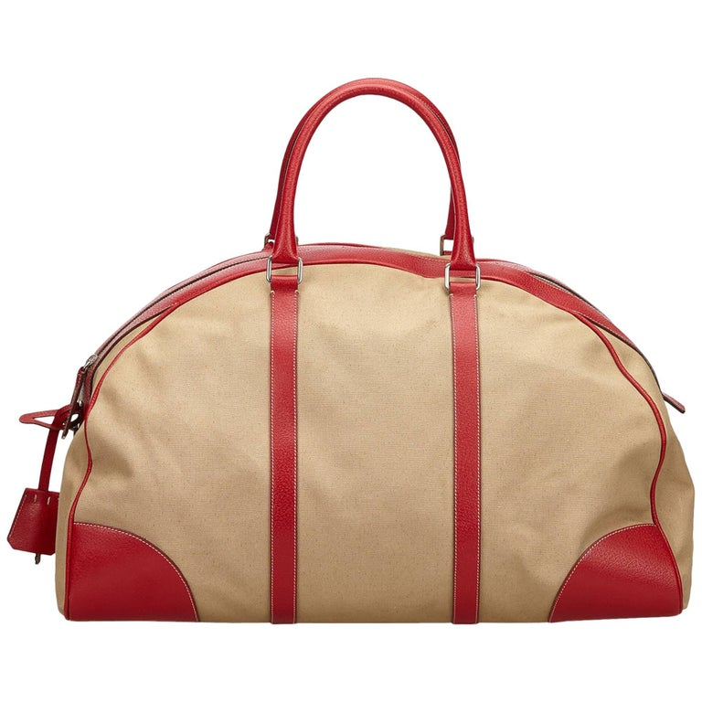 b38ecd20a30d61 Prada Beige x Red Canvas Leather Trimmed Weekender at 1stdibs