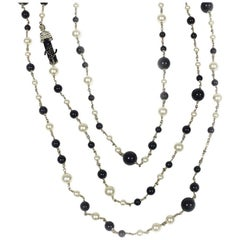 CHANEL Multi-Row Necklace in Black and White Pearls, CC and Coco Figurine