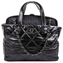 Chanel Bag in Aged Quilted Black Leather and Dark Gray Tweed