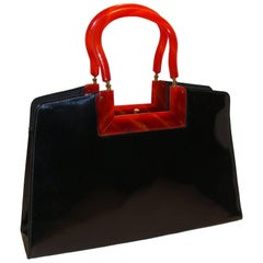 Architectural and Chic Black Patent Bag with Lucite Frame and Handles