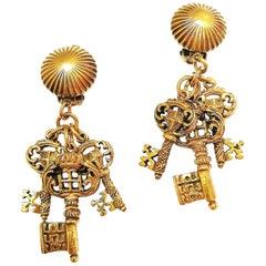 Antiqued gilt metal 'key' drop earrings, Selini, 1960s