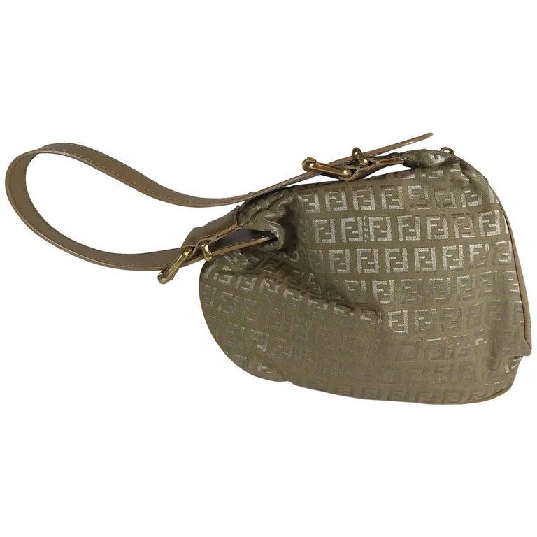 eda1df71ef6d Fendi Zucca Oyster Bag For Sale. Tan Zucca canvas.