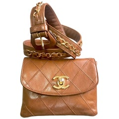 Chanel Vintage brown belt fanny pack hip bag with gold CC motif and chains