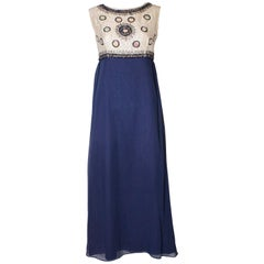 A Vintage 1960s sequin blue chiffon evening gown by Laura Phillips