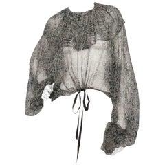 A Vintage Yves Saint Laurent Rive Gauche Transparent Ruffle Blouse