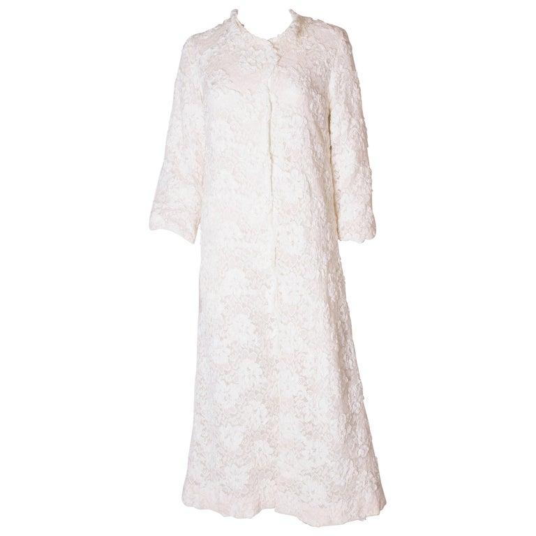 A Vintage 1960s White Ribbonwork summer Coat