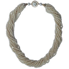 Twelve Strand Glass Pearl Necklace with a Gold Tone and Pearl Clasp