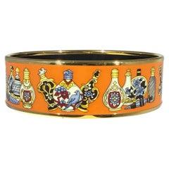 Hermes Orange and Gold Enamel Bangle Medium