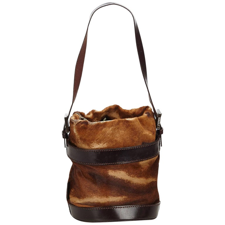 c729b4e095ab Fendi Brown Ponyhair Bucket Bag For Sale. This bucket bag features a pony  hair body with leather trim ...