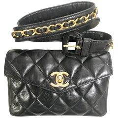 Vintage CHANEL black lamb belt bag, fanny pack with golden chain belt and CC.