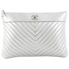 Chanel O Case Clutch Chevron Lambskin Medium