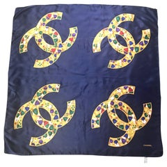 Vintage CHANEL navy silk scarf with gold, red, purple, green jewelry print in CC