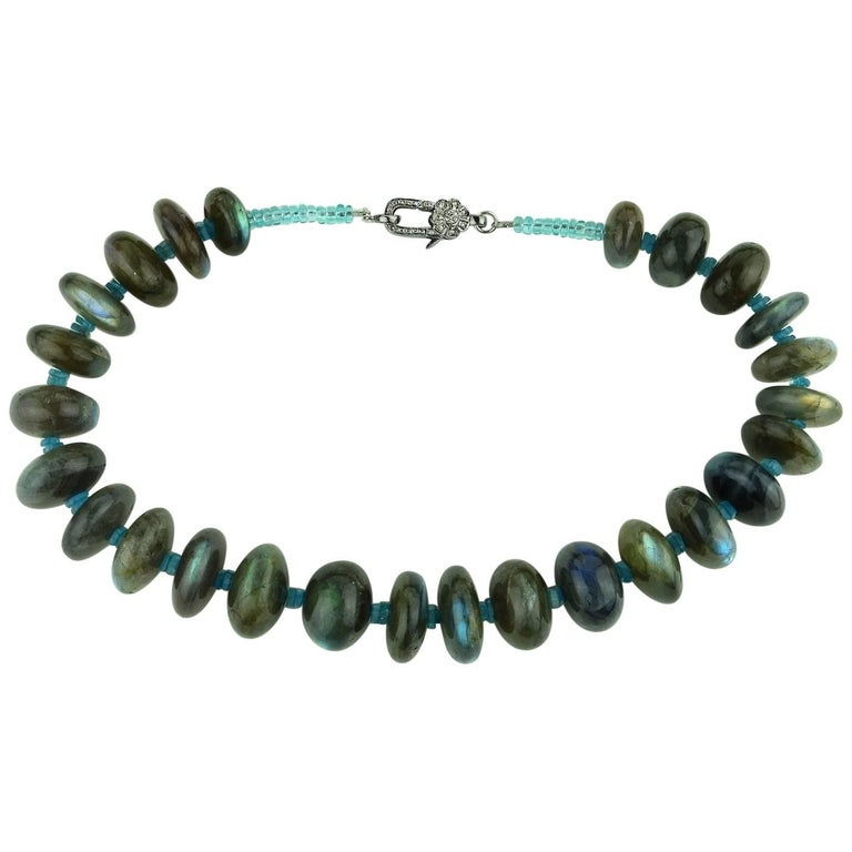 Statement choker necklace of highly polished Labradorite rondels accented with teal Apatite. These large, 16-21MM, Labradorite rondels are lovely shades of silver,gray, green, blue, and green.  The necklace is finished with an antiqued Sterling