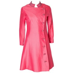 A vintage 1960s dusty pink dress coat by Petite Francaise