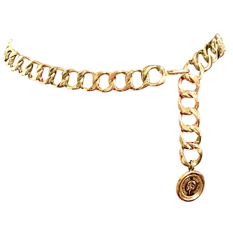 MINT. Vintage CHANEL golden thick chain belt with CC and mademoiselle charm.