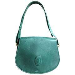 Vintage Cartier green grained leather oval round shape shoulder bag. Rare color
