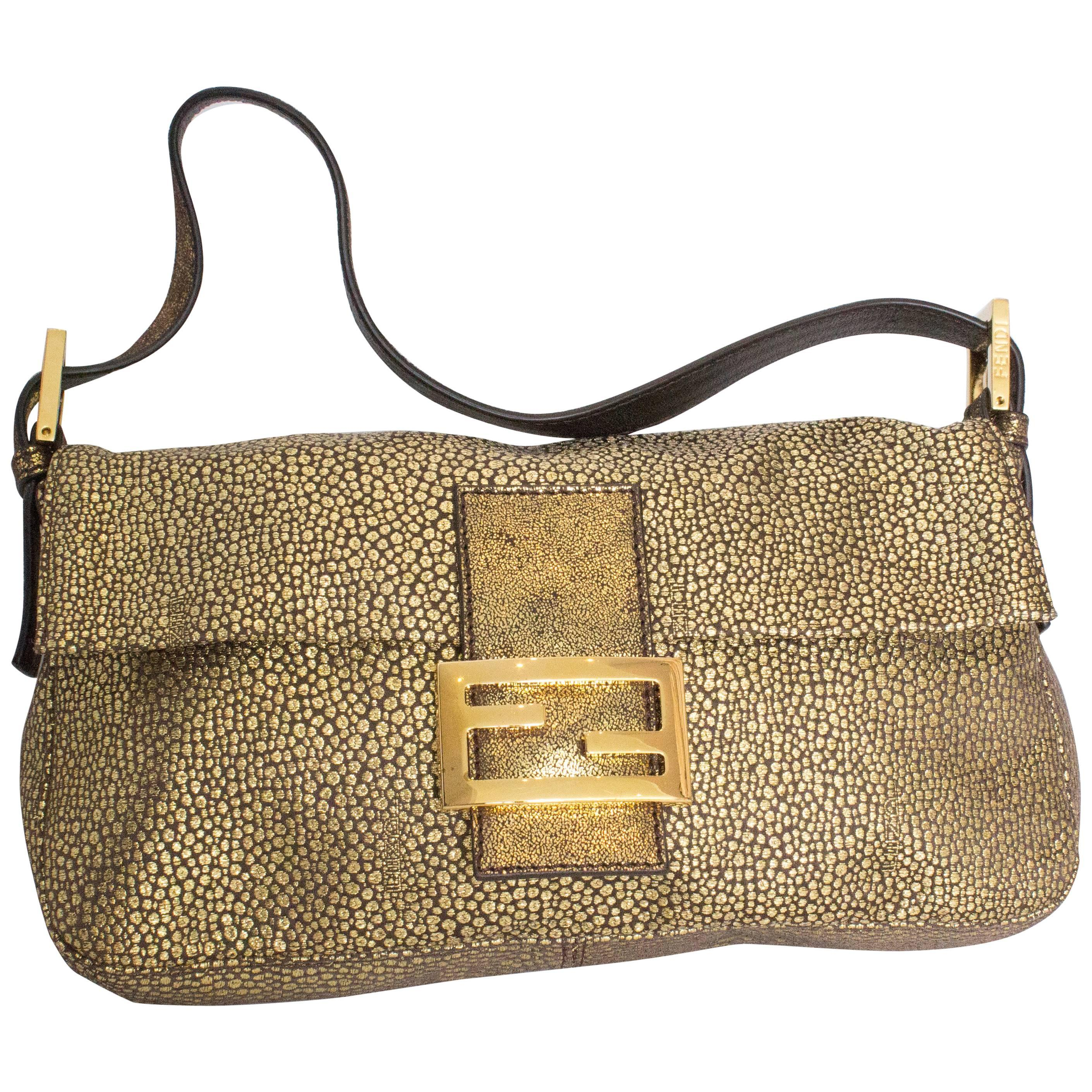 1a9ceb8bf3f8 A Vintage metalic gold classic Fendi Baguette Bag at 1stdibs