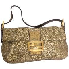 A Vintage metalic gold classic Fendi Baguette Bag