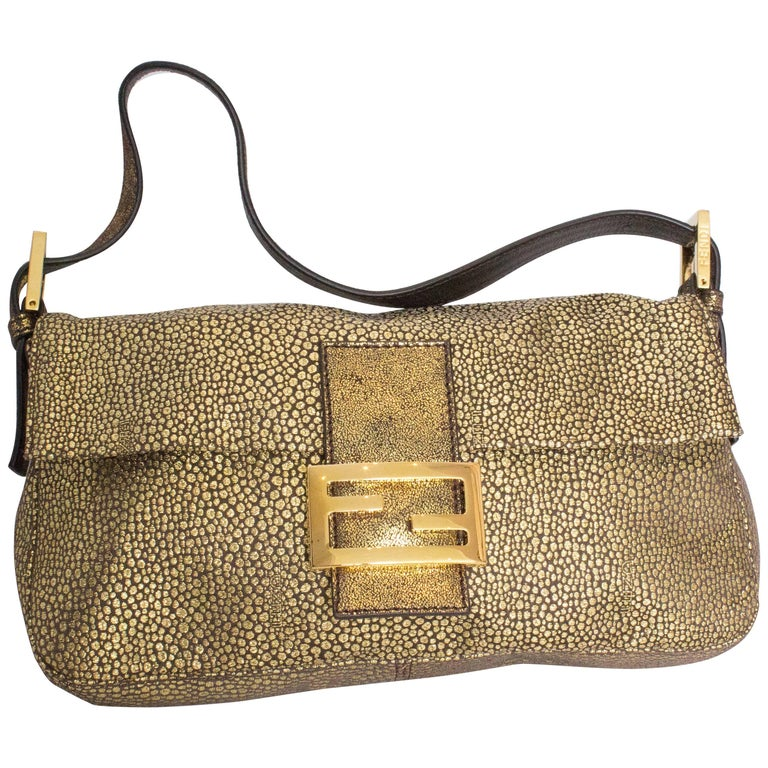 A Vintage Metalic Gold Classic Fendi Baguette Bag For