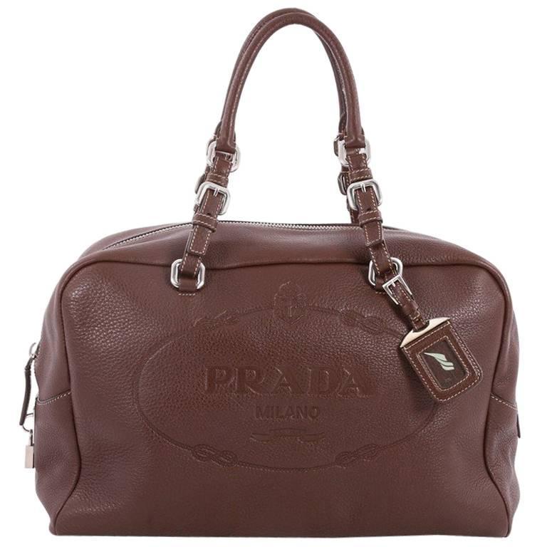 cf9633f513ab Prada Embossed Logo Bauletto Handbag Vitello Daino Large at 1stdibs