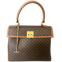 Vintage CELINE brown logo printed Kelly style handbag with golden closure.