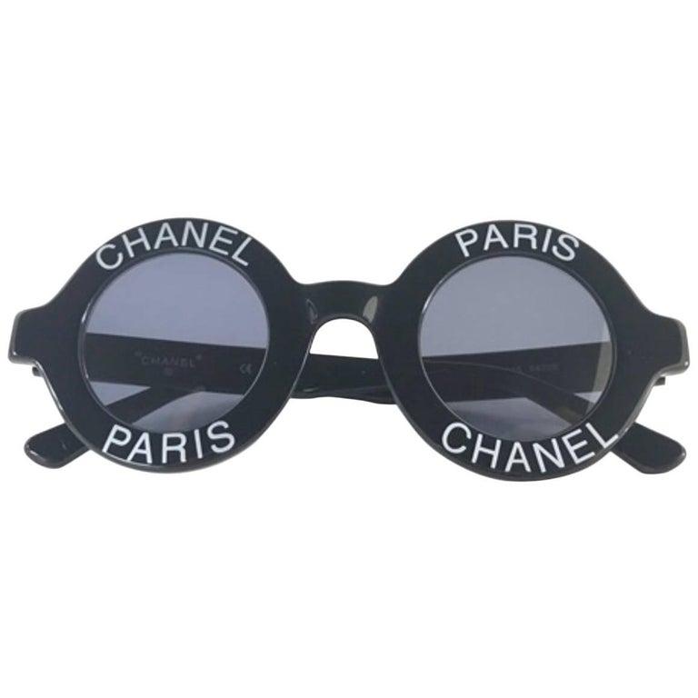 Chanel Vintage black round frame mod sunglasses with white CHANEL PARIS logo