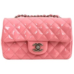 Chanel Mini rectangle crossbody Flap Bag in pink quilted patent leather