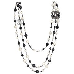Chanel 2011 Black Bead & Ivory Faux Pearl CC Three-Strand Necklace