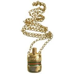 MINT. Vintage Gucci golden mini perfume, eau de cologne bottle chain necklace.